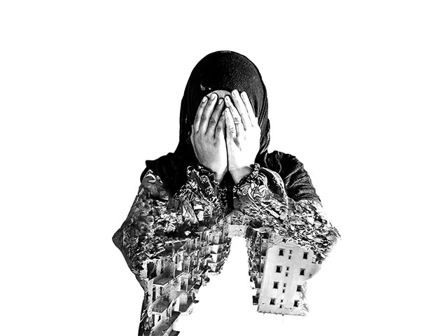 A Syrian woman holds her head in her hands