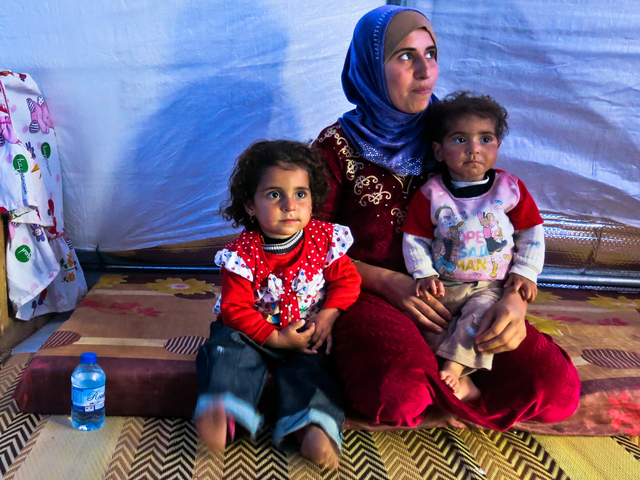 A woman and her children in their tent in Khazer camp, where tens of thousands of IDPs have been living since the 17th October.