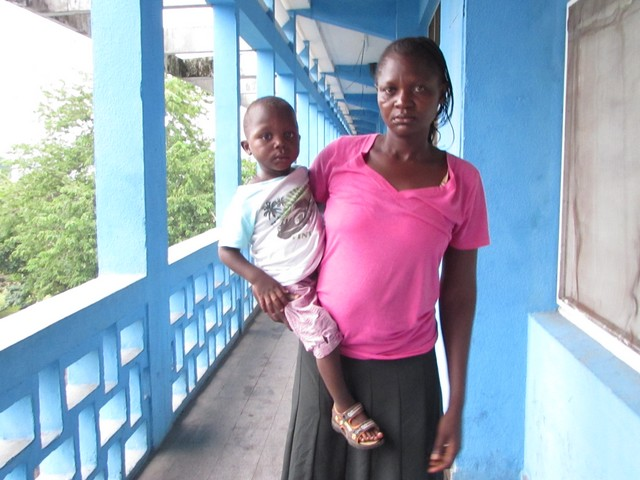 Two-year-old Glody with his mum. Democratic Republic of Congo.
