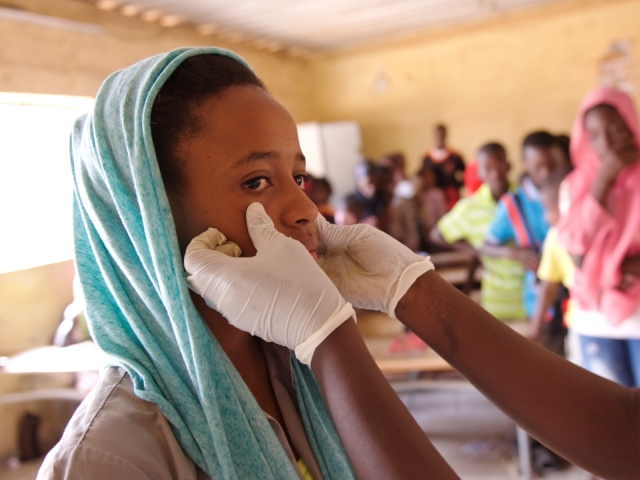 Adama Awa Ba, a twelve-year old school girl, undergoes a medical visit in a primary school in the Patte d'Oie district of Dakar.