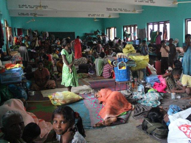 During Sri Lanka floods, thousands of people were displaced in temporary shelters.