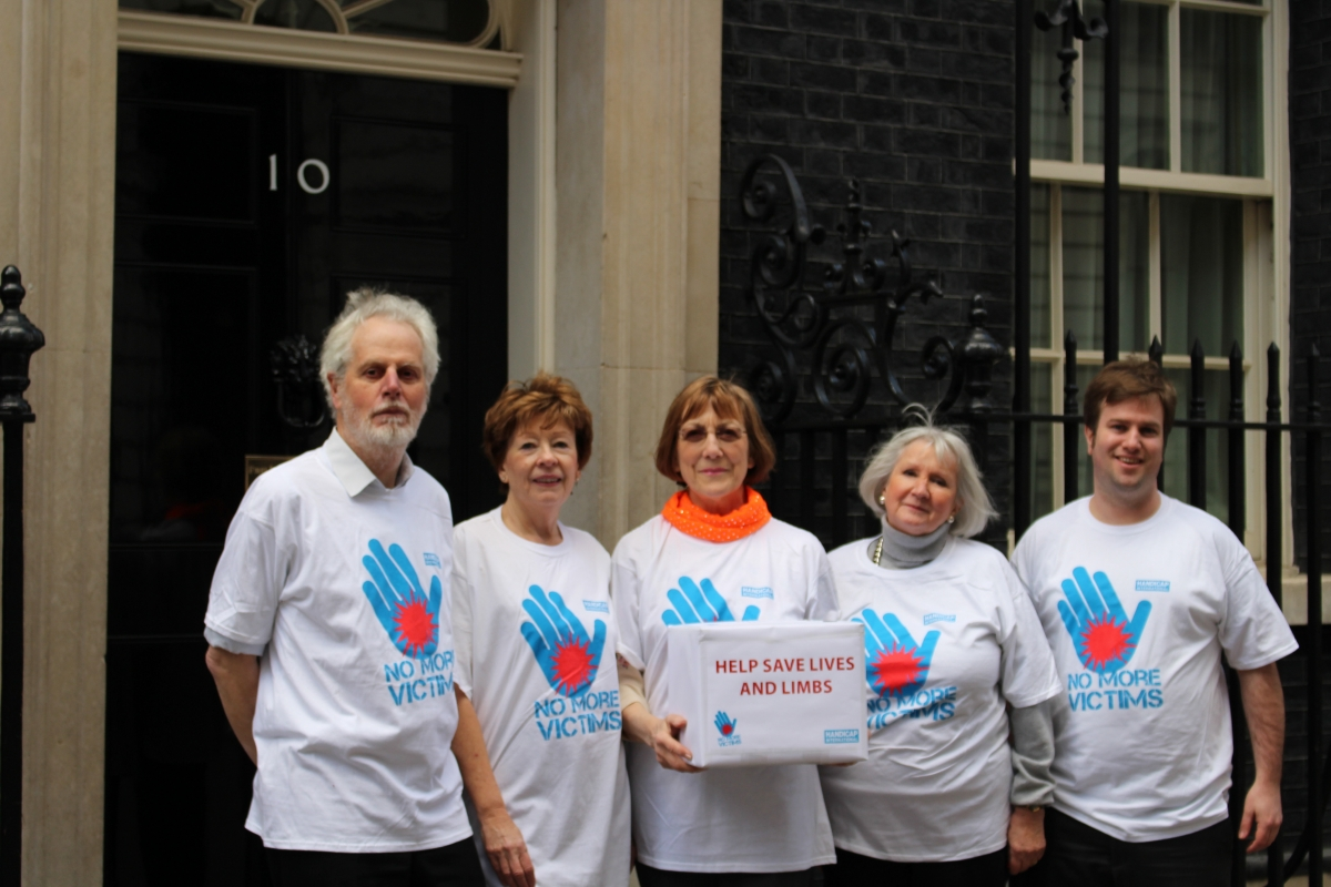 Campaigners hand in a 60,000 signature petition at Downing Street to protect civilians