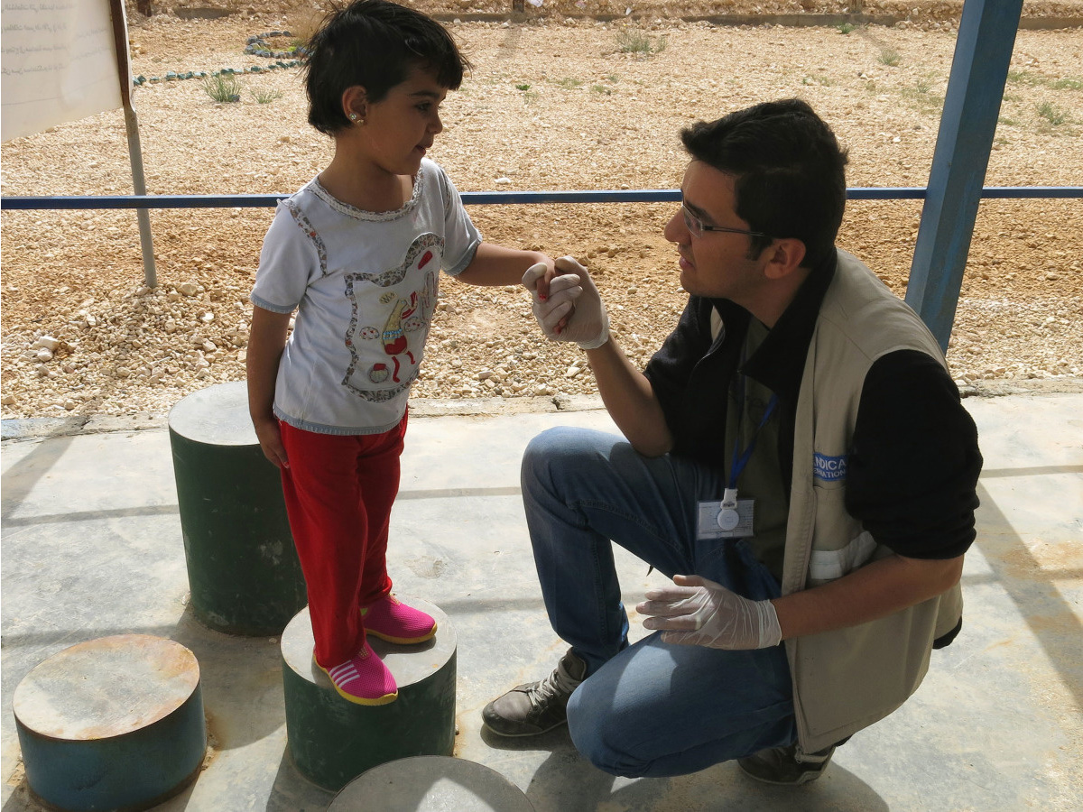 Malak, 5, practising steps with physiotherapist Mohammed