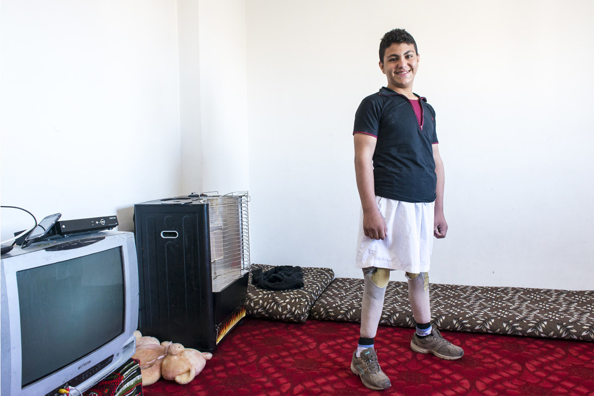 Qusay standing tall on his new legs