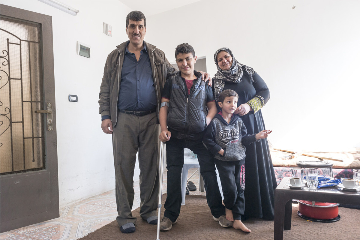 Qusay with his family