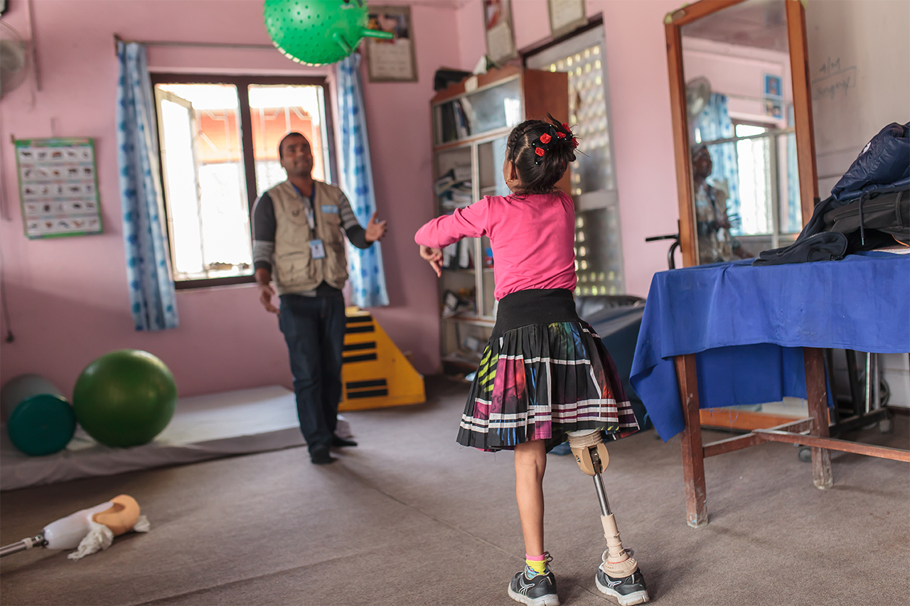 Nirmala during a rehabilitation session with her physiotherapist.