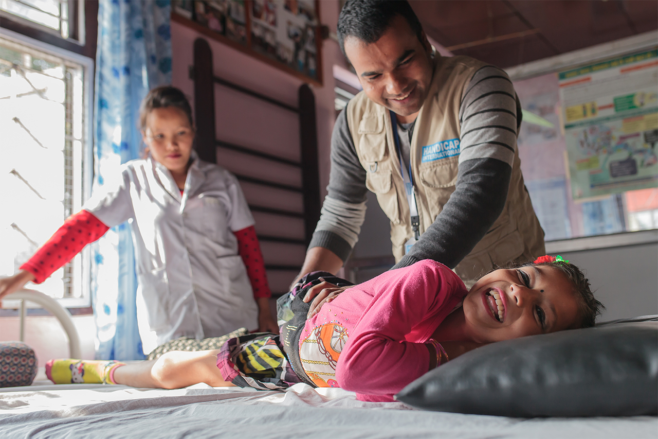 Nirmala during a rehabilitation session with her physiotherapist and his assistant.