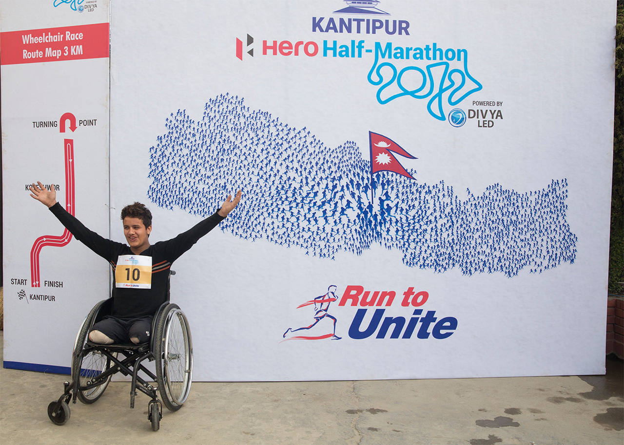 Ramesh celebrates his victory after coming sixth in the 3km race