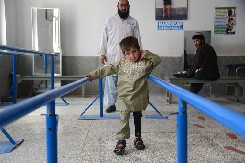 Sayed learning to walk again at Handicap International's rehabilitation centre in Kandahar, Afghanistan.