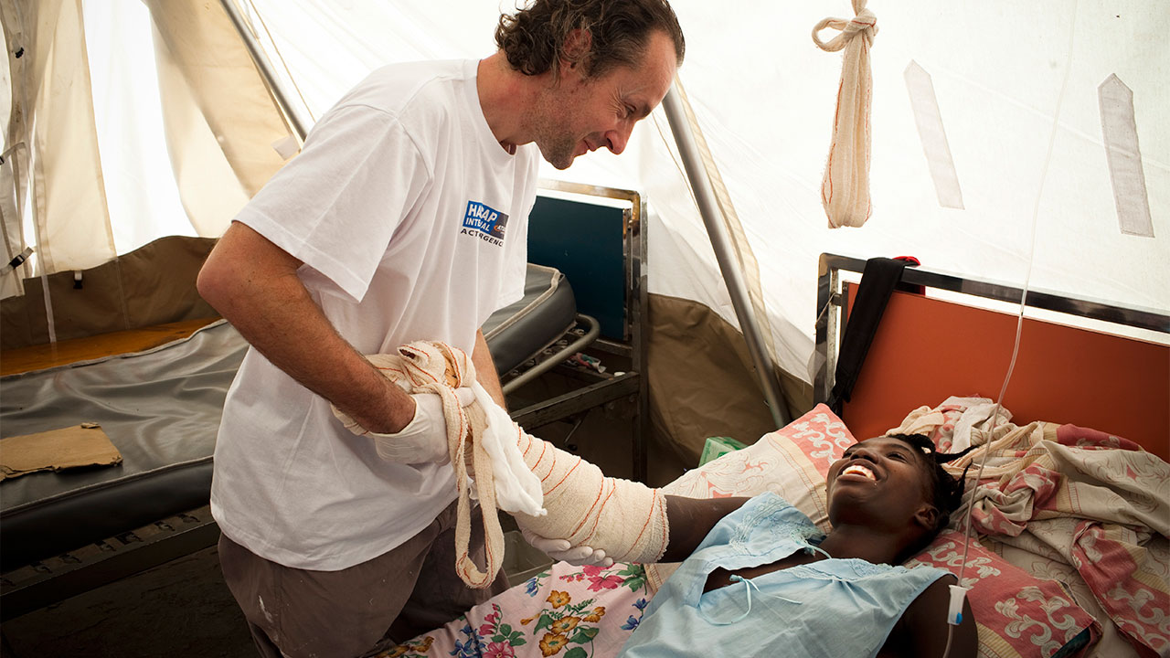 Physiotherapist Olivier Champagne with a patient, Yolande, in an MSF hospital.