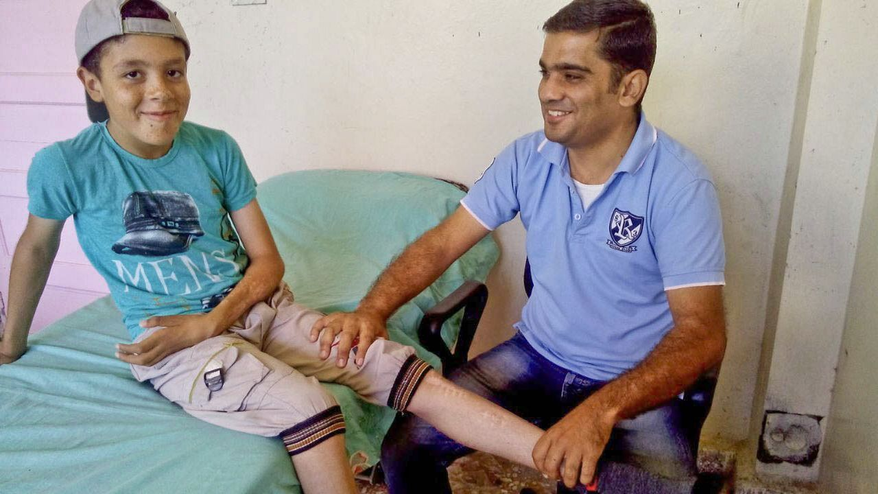 Mohammad and his physiotherapist