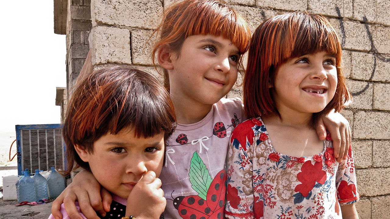 Three sisters who fled with their family to Kirkuk, Iraq, when Islamic State took over their town.