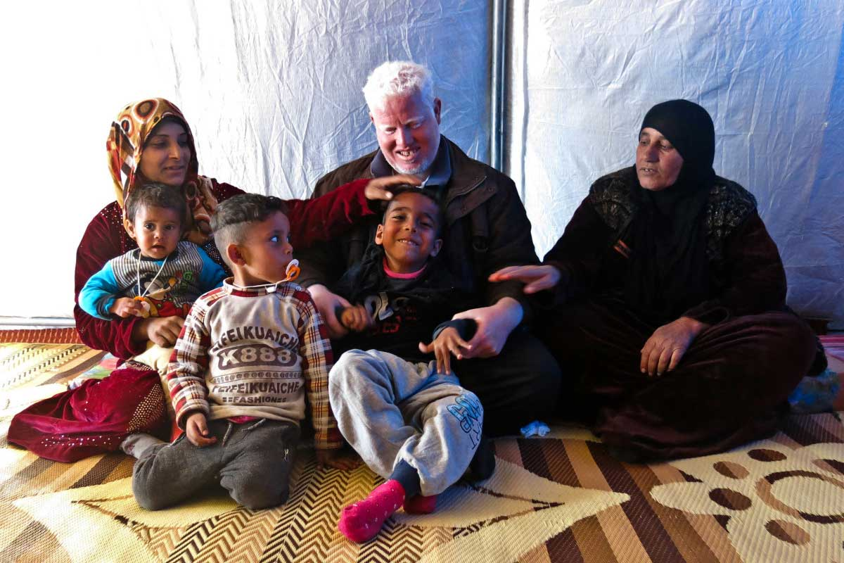 Zeidan in his tent with his family