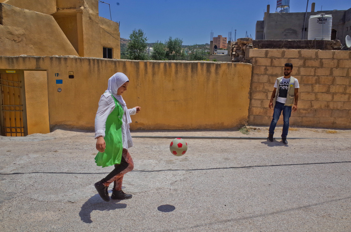 Salam practices her football skills.