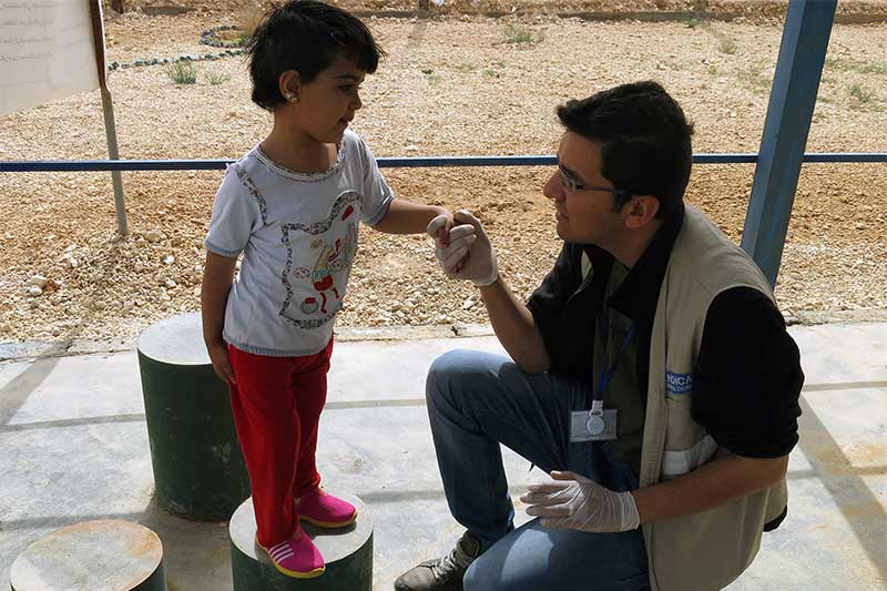 Malak having a rehabilitation session with a Handicap International physiotherapist, in Jordan.