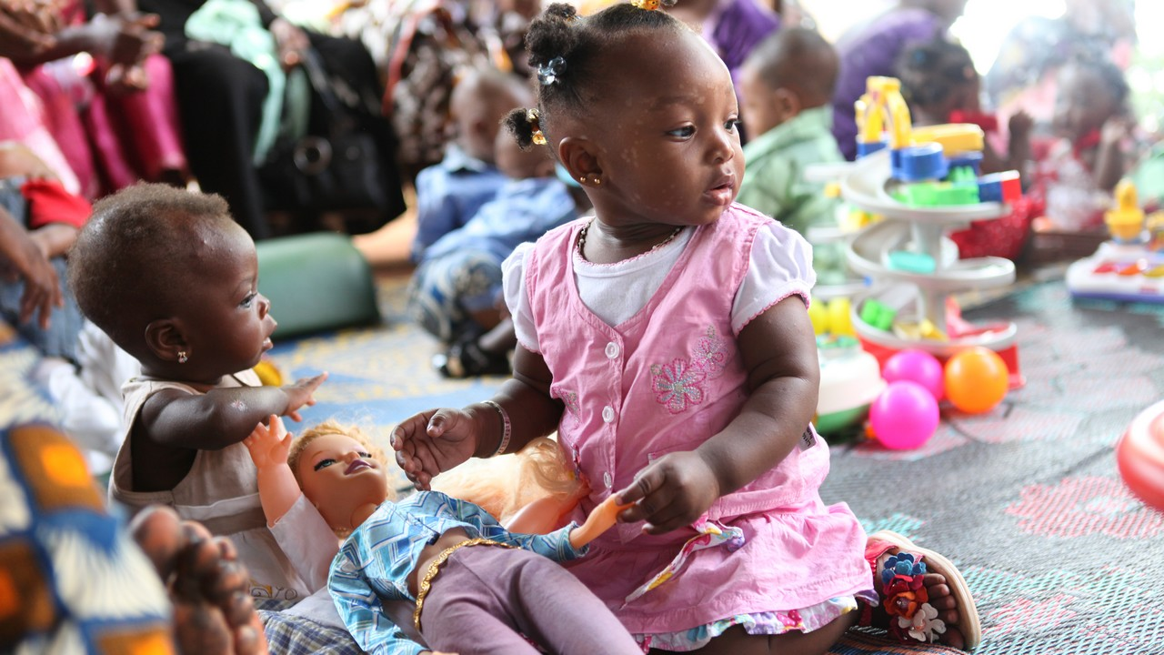 A young girl enjoying a play space at a health centre in Bamako, Mali.