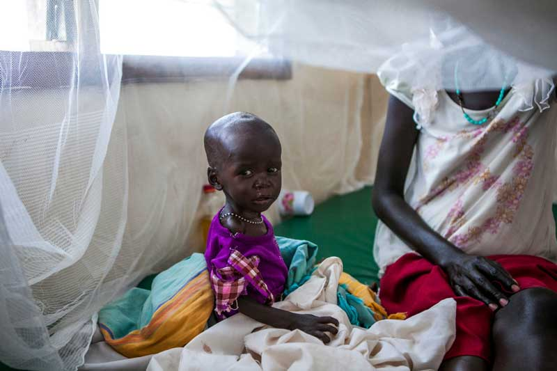 Agnes recovering in bed in Kakuma camp