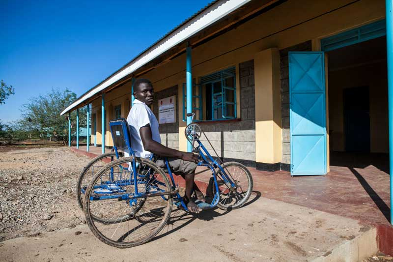 Yussef entering a school building, Kakuma camp
