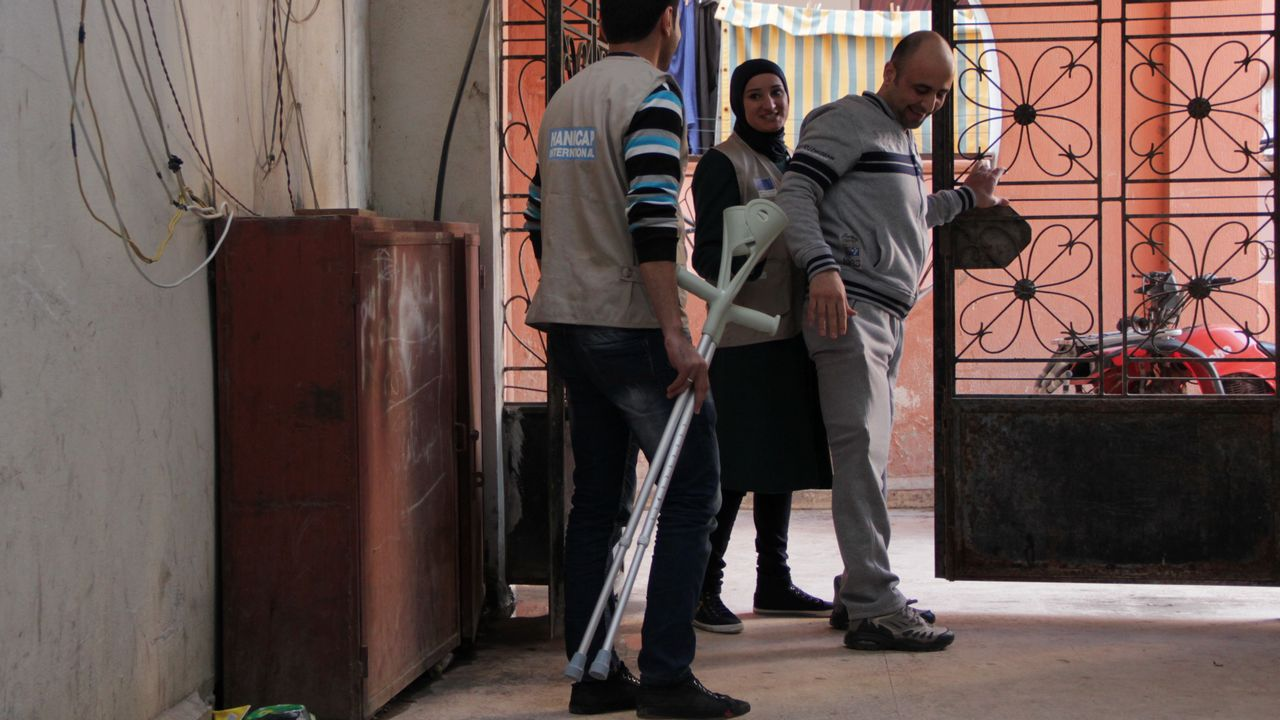 When he started his rehabilitation Mohamad couldn't leave his bed; two and a half months later he was able to walk using a pair of crutches.