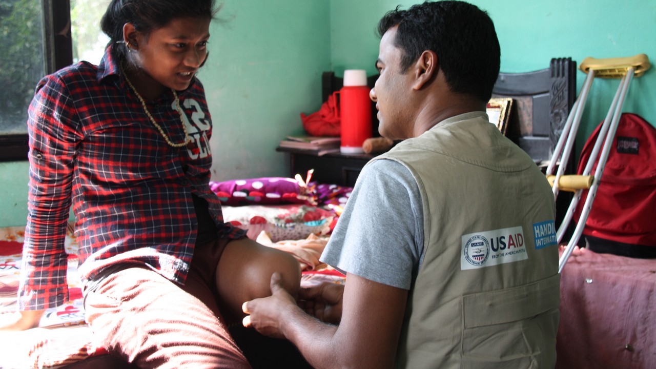 Earthquake survivor, Priya, 14, during a rehabilitation session with a Handicap International physiotherapist.