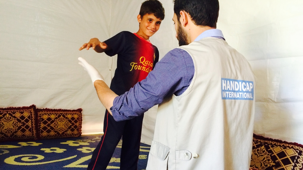 Mostafa, 8, in a physiotherapy session. Lebanon.