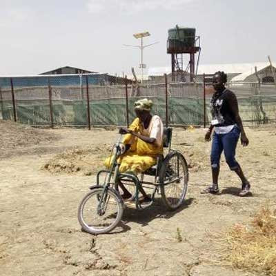 Mary using her hand tricycle, Malakal, South Sudan