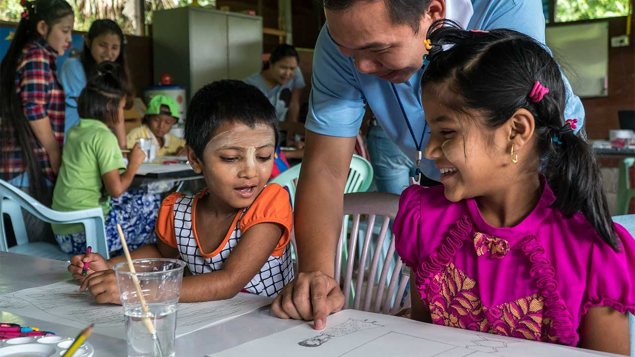 Sanda takes part in a drawing activity organised by HI in a refugee camp in Mae Sot, Thailand.