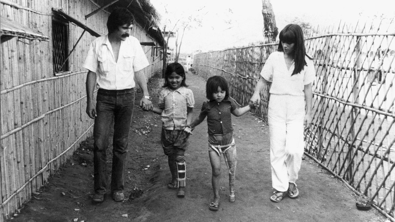 Jean Baptiste and Marie Richardier with 2 disabled children, Mom and Sorpin, in the Khao I Dang refugee camp on the Thai-Cambodia border, 1980s