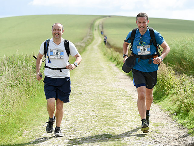 Rupert (right) and his running partner, Al, running the South Downs Way