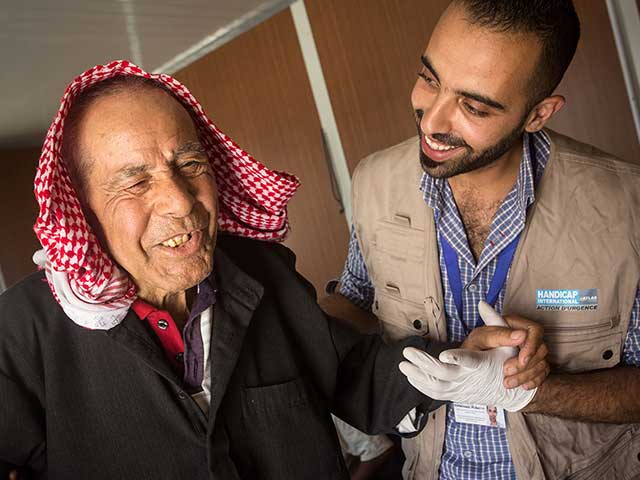 Jomaa, a 85 year old Syrian refugee, having a rehabilitation session.