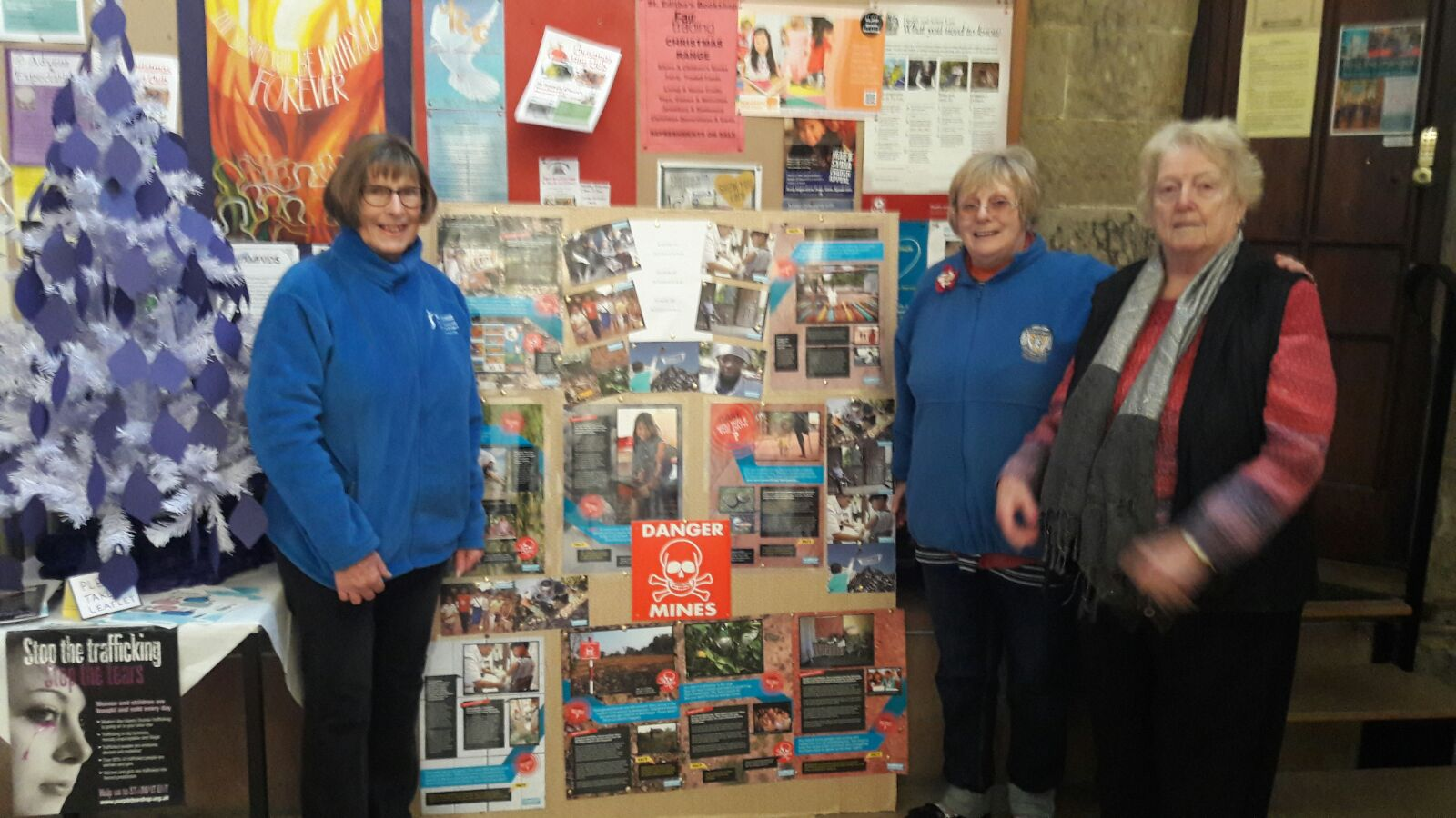Tamworth Soroptimists with their display consisting of Syria's Young Survivors posters and the 'Dare You Walk the Path?' exhibition at St Editha's Church, Tamworth.