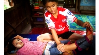 Hae Tar in Handicap International's rehabilitation centre. 'It's a good thing that she exercises, but often I worry she'll fall down', her sister says.