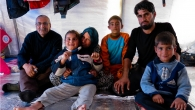 Tiba, her grandparents, father and brothers in their tent.