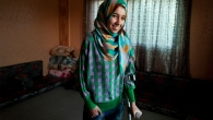 Roqaya lost both legs legs in a bombing in Syria. Handicap International fitted her with prosthetics and helped her learn to walk again.