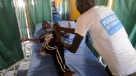Halima, 9, in a rehabilitation session with a Handicap International physiotherapist.