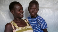 Omot Ochang, a South Sudanses girl with cerebral palsy, and her mother at a refugee reception centre in Kenya, May 2017.