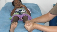 A child receiving care from Handicap International's mobile team