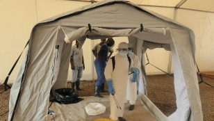Ebola crisis. Teams testing an inflatable tent. Sierra Leone.