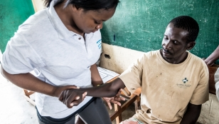 A man with hemiplegia receiving rehabilitation care from a Handicap International physiotherapist, Haiti.