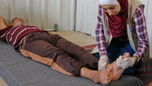 Ahmed has a rehabilitation session with a Handicap International physiotherapist in Azraq camp, Jordan