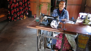 Landmine victim, Seng Ly, established her sewing business with the help of Handicap International