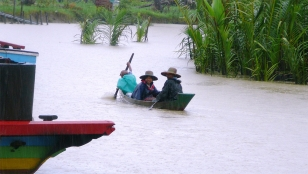 This photo of residents in the village of Kun Thee Chaung was taken during previous flooding, caused by Cyclone Nargis in 2008. Myanmar.