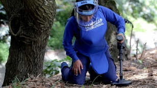 A female deminer undergoing training in Colombia.