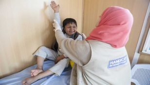 Noor, who has been paralysed in his right arm since he was born, during a rehabilitation session in Azraq refugee camp, Jordan.