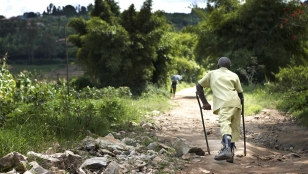Claude, 15, walking home from school, Muhanga District, Rwanda.