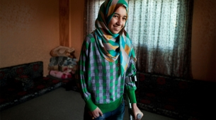 Roqaya, who lost both her legs in a bombing on Syria