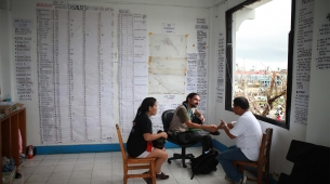 Sylvian Riccio, a member of our emergency team, meeting local representatives at the town hall in Guiuan to establish the needs in the area. Behind them, a list of casualties and missing people covers the walls. The south coast of Samar and Eastern Samar provinces in the Philippines were severely hit by Typhoon Haiyan.