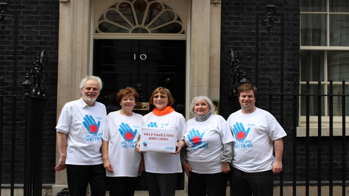 Martin (left) with campaigners outside 10 Downing Street.