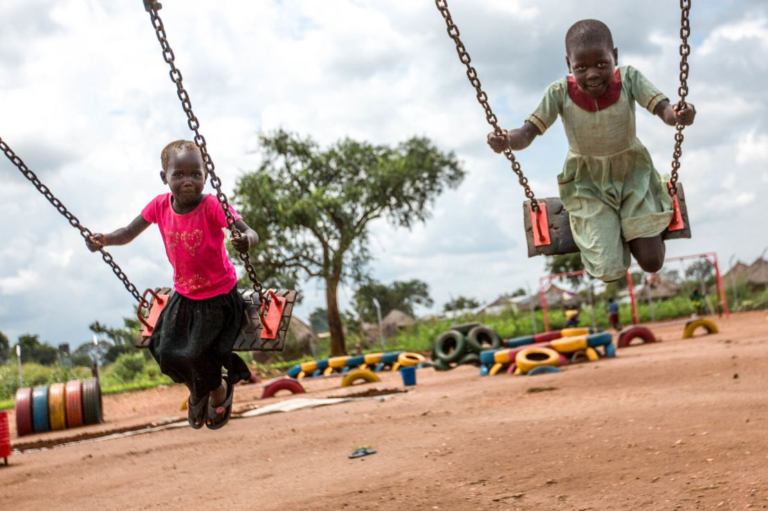 Children play on swings in the newly opened settlement Omugo
