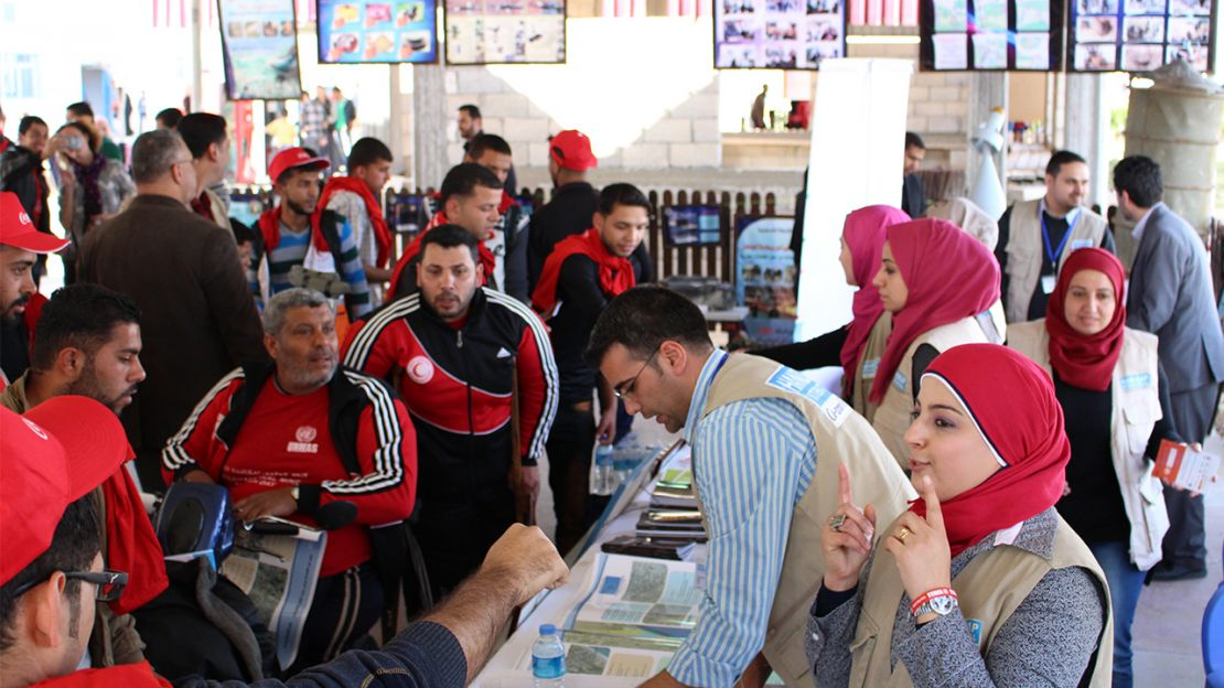 HI's information stand at an event in Gaza, April 2015